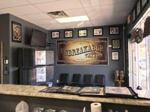 unbreakable tattoo studio 326e959 1 300x225